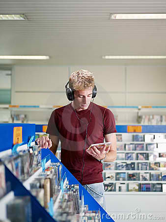 Guy Listening to Music CD